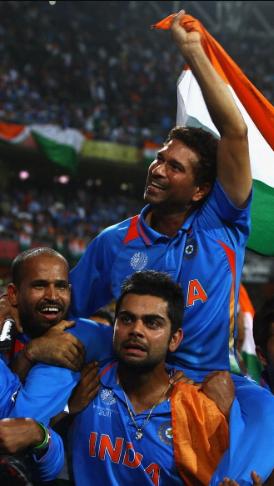 Sachin Tendulkar and Virat Kohli in World Cup 2011 winning celebration
