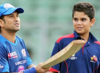 Sachin Tendulkar babysitting his son