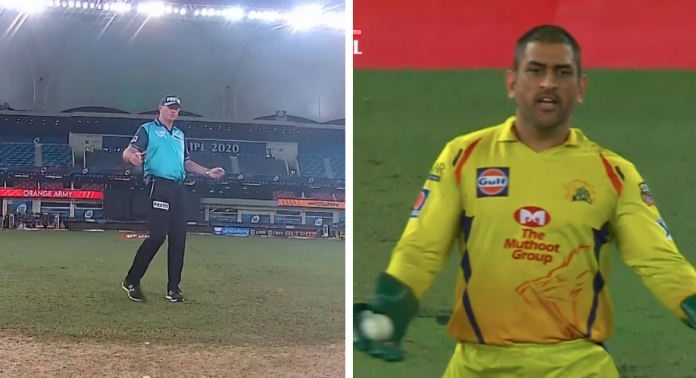 Dhoni makes an angry gesture while on field umpire Paul Reiffel attempts to signal a wide.