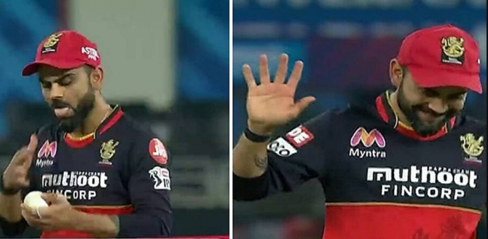 Virat Kohli makes an apology gesture while trying to apply saliva
