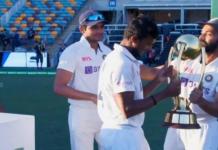 Rahane Handing Over The Test Trophy To Debutant T Natarajan