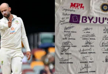Nathan Lyon reacts on receiving a Signed Jersey from India