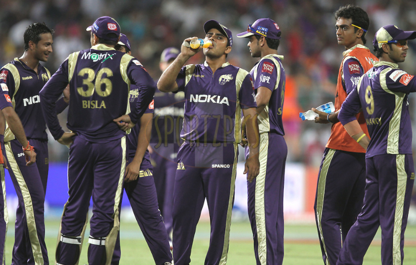 KKR players during a drinks break