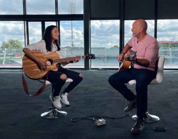 Jemimah Rodrigues plays guitar with Mark Butcher