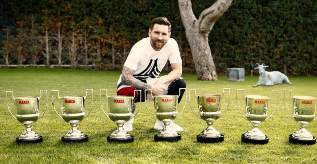 Messi with his seven Pichichi Trophies