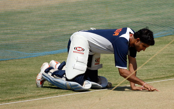 Ganguly examines the playing pitch